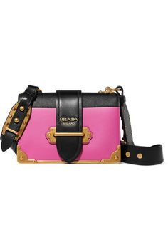 Prada's 'Cahier' bag is one of our favorite accessories for the season. Immaculately crafted in Italy from smooth and textured-leather, this black and pink design is framed with brass hardware - inspired by ancient books - and has a roomy accordion silhouette. Adjust the strap to carry it on the shoulder or cross-body.