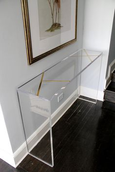 Lucite 1.25 thick console table with solid brass Inlay. Measures: 52 L x 34H x 12 D  Consume sizes available. Please contact for a shipping quote and lead-time BEFORE you order. Handmade in brooklyn. Please contact for more information.
