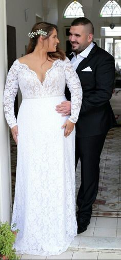 Plus size lace mermaid wedding gown with off shoulder long sleeves. As flattering and feminine as it can be! Reut. Studio Levana