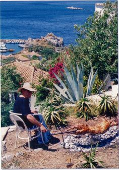 Easter - Hydra - Greece - cooking the arni (traditional lamb) everyone must have a turn