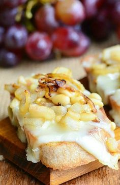Brie Crostini with Caramelized Onions, Pear and Pine Nuts - Your guests won't want to stop reaching for this creamy and indulgent appetizer.