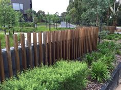 upright corten steel fins highlight Option: 1 Visitor Carparking visitor carp parking bay these are place immediately behind low stone garden bed, dirrctly opposite garage along boundary fence