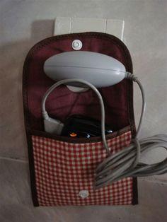 Porta-carregador de celular -em uso