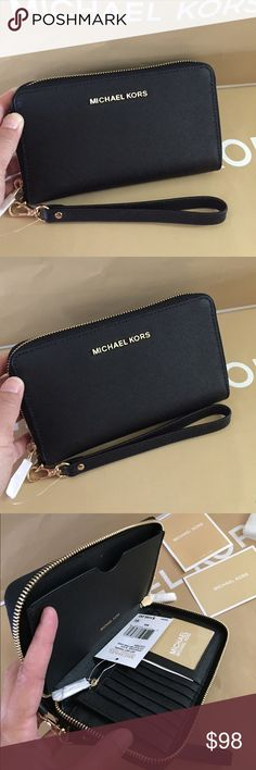 """💐Michael Kors Jet Set Travel Large FM Phone Case 🌹🏝100% Authentic Michael Kors Jet Set Travel Large Flat Multifunction Phone Case🌹😍 Crafted in Saffiano leather, it has a removable wrist strap, zip around closure and goldtone hardware. The interior features a back wall phone pocket, zip coin pocket, credit card slots and an ID window.   Specifications Material100% Cow Leather OriginImported Dimensions6.5"""" x 4"""" x 1"""" Fabric CareSpot Clean with damp cloth Michael Kors Bags Clutches…"""