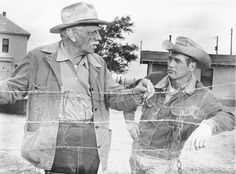 """Melvyn Douglas and Paul Newman in """"HUD"""". Newman is wearing the iconic Lee denim Storm Rider jacket — blanket-lined, with a corduroy collar. Douglas is wearing a classic chore coat. This image appears to be reversed– you can tell by the fact that the jacket plackets should be left-over-right."""