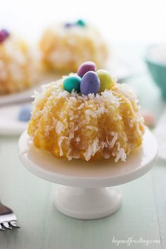 These Mini Lemon Bundt Cakes are covered in a vanilla glaze and shredded coconut. It's an east Easter dessert recipe you can share with family and friends. New Year's Desserts, Desserts To Make, Easter Desserts, Easter Cake, Easter Food, Easter Dinner, Easter Treats, Sweet Desserts, Holiday Desserts