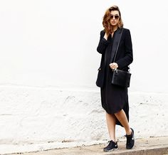 Chronicles of Her blogger pairs her high-low black dress with a sleek tuxedo jacket and sneakers for the ultimate coo-girl outfit