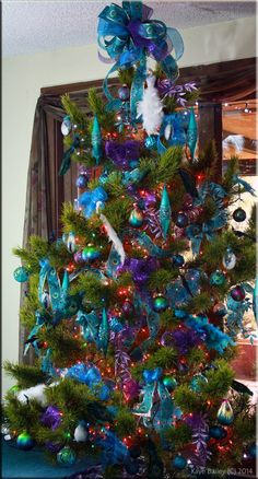 I enjoy a theme in my Christmas decorating and this year have attempted to capture Peacock Splendor. My vision includes copious use of sp. Peacock Christmas Tree, Old Christmas, Christmas Cards, Christmas Decorations, Christmas Things, Christmas Trees, Purple Palette, Seasonal Decor, Holiday Decor