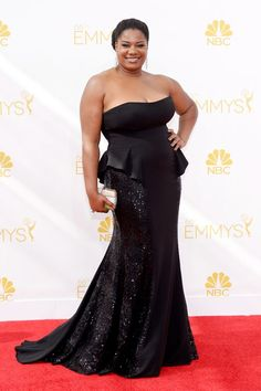The Emmy Red Carpet's Most Amazing Plus-Size Looks #refinery29  http://www.refinery29.com/2014/08/73460/best-plus-size-emmy-looks#slide-6  Adrienne C. Moore The OINTB star's flared bustier and gently fluted, sparkly skirt make a fine case for sleek separates in lieu of a poufy, red carpet dress. We think the ever-unpretentious Black Cindy would approve.
