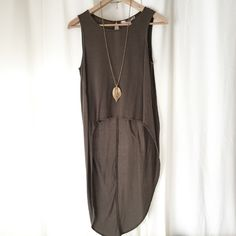Extreme High Low Tank Olive green high low tank with key hole button in the back. Super cute in the summer with cut off shorts and a chain necklace :) Care tag was cut off - cold water gentle wash cycle/tumble dry low or hang dry. Worn once. Forever 21 Tops Tank Tops