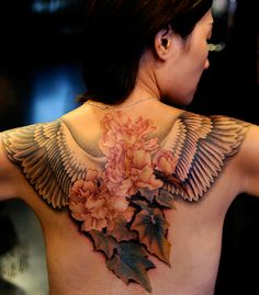 angel wing and flowers tattoo on the back