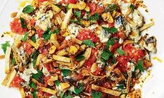 Yotam Ottolenghi's warm yoghurt and aubergine with fresh tomato shredded pitta crisps.