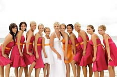 Bridesmaids in hot pink and orange - see more on http://themerrybride.org/2014/04/19/pink-and-orange-wedding/