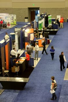 Vendors in the Exhibit Hall at the Utah Valley Convention Center during a trade show.