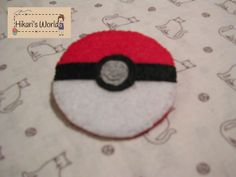 Handmade pin of a Pokeball from the anime Pokemon. $2.40