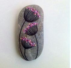 Dandelions on my way rock--mine would NOT be pink, but it's cute. #howtomakepaintedrocks  #paintedrockscraft  #rockpaintingideas  #rockpaintingimages  #rockpaintingpictures  #rockpaintingideasforbeginners  #paintingrocksforgarden