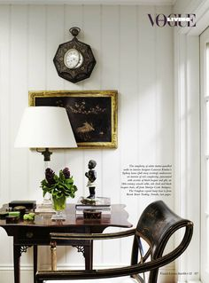Living room detail: Black lacquer & gilt against white - home of designer Cameron Kimber