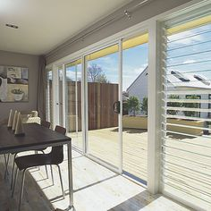 Downstairs Living Room, onto patio. Triple stack sliders, one way, next to louvres, with recessed track. Exactly as quoted in final contract. Stegbar, Aluminium Sliding Doors