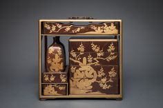 19th Century Picnic Set, with Saki containers and compartmentalized box for food. Also serving and eating trays.  Gold pine and plum design on Nashiji.