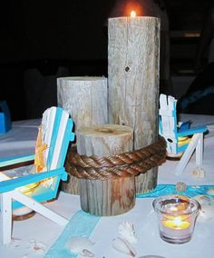 Beach Themed Wedding Reception: Custom Made Dock Post Candle Holder, Adirondack Chair Candle Holders, Votives and Seashells.