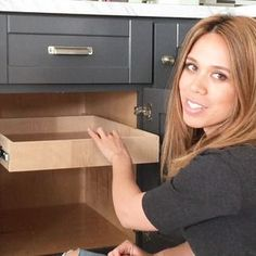 Check out this project on RYOBI Nation - It's easy to convert a kitchen cabinet shelf into a much more functional pull out drawer.  All you'll need is drawer slides, a little bit of wood for boxing in the drawer, and some basic power tools.