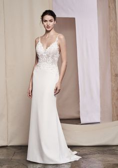 Look your best in this crepe slim gown. Intricate beading with Venice lace illusion bodice. Lace along the back hem finishes the dress.
