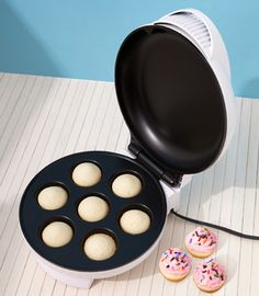 $38 mini cupcake maker. since i just had to find 500 cupcakes for a recent holiday party this week, i think this is probably a good investment for the foodies. slash, girls who bake/eat cupcakes.