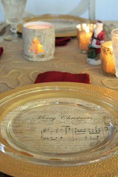 Christmas sheet music is the inspiration this year for my Christmas table. I just cut out large paper circles and nestled them between a gold charger plate and a glass dish.  Just use a salad plate as a template to trace a circle.