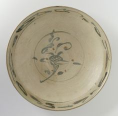 Dish with Cursive Floral Spray, Vietnam, late 14th century. Wheel-thrown stoneware with cream slip, underglaze brown painted decoration, and clear glaze. Height: 2 1/8 in. (5.4 cm); Diameter: 11 11/16 in. (29.69 cm). Los Angeles County Museum of Art, Gift of Ambassador and Mrs. Edward E. Masters (M.84.213.243). Photo © Museum Associates/LACMA