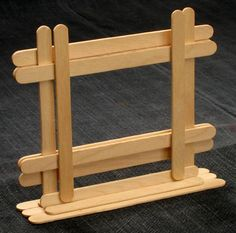 popsicle stick photo frame... I think we have a winner!