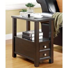 Featuring a shelf and drawers for storage, this table will add a sense of style to any home. This accent table with its dark cappuccino finish will add a touch of contemporary sophistication and classic beauty to any living or dining space.