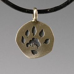 handcrafted animal track charms, silver river otter  totem jewelry, river otter  track
