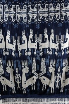 Vintage Indigo IKat from Sumba Indonesia. This vintage Ikat, woven, with stylized birds and animals has been dyed with a natural deep indigo ,finished with a fringe on both ends, making it a stunning piece to hang on any wall. Approx 40years old 230cm length x 118cm width