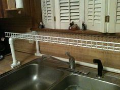 I really dont like giving up counter space for a dish drain. So I made this from wire shelf and pvc pipe works really great. Had one @ old house suspended from upper cabinets with a pipe and a couple pieces of rope...That was really great...