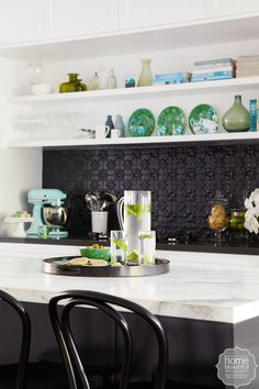The centrepiece of the stylish kitchen is a metre-long island bench, topped with slabs of Calacatta marble. The on-trend splashback of inexpensive pressed metal, found at Chippendale Restorations, was spray painted in Dulux Domino to team with the Caes Kitchen Reno, Kitchen Backsplash, New Kitchen, Kitchen Dining, Kitchen Ideas, Paint Backsplash, Kitchen Magic, Kitchen Inspiration, Kitchen Countertops