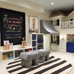 Fabulous girl's playroom features a built-in playhouse composed of a white…