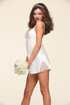 3 sexy must-haves: a tiara, a white bouquet & a silky little slip.