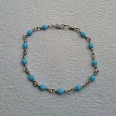 Bracelet en fil inox + perle de verre bleue claire