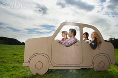 People playing with cardboard car