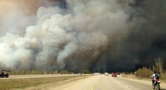 Smoke fills the air as people drive on a road in Fort McMurray, Alberta on Tuesday May 2016 in this image provided by radio station O Canada, Alberta Canada, Wildland Fire, Fort Mcmurray, Pet Travel, Climate Change, Rage, At Least, Country Roads