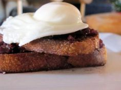 Eggs in Wine: poached eggs over thick-cut fried sourdough smothered in a red wine bacon shallot sauce