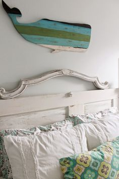 Beachy themed tween bedroom. Simple but girly color palette. White and aquas, with a pop of yellow. A mix of two beddings, and some custom made pieces. Reclaimed door headboard and nightstand combo.  Theraggedwren.blogspot.com