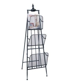 Three-tier magazine rack with wire mesh shelves and a finial top. Product: Magazine rackConstruction Material: MetalColor: BlackDimensions: H x 16 W x 16 D Household Organization, Organization Hacks, Organizing Tips, Newspaper Stand, Funky Furniture, Furniture Ideas, Rustic Design, Joss And Main, Office Decor