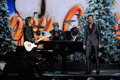 "Keith Urban and Jimi Westbrook of Little Big Town perform ""Santa Claus is Back in Town"" on ABC's ""CMA Country Christmas"" (12/1/11)."