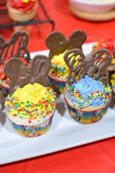 Mickey Mouse Cupcakes with homemade chocolate mickey ears. Use melted chocolate and trace a mickey ears outline to make a tasty mickey cupcake topper. Mickey Mouse Cupcakes, Mickey Mouse 1st Birthday, Mouse Cake, Mickey Ears, Chocolate Candy Melts, Melted Chocolate, Cupcake Cones, Cupcake Toppers, Homemade Chocolate Cupcakes