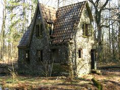 abandonedography:  When the Germans were invading Denmark in world war II, they took over a mans farm. This man moved into the deep forrest and made a new home out of stone surrounded by a moat. This place is in Jylland, Denmark.  (by Lone)