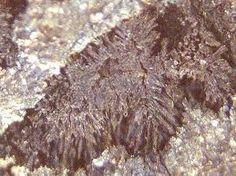Maucherite.Colour:reddish silver-white, turning darker reddish grey on exposure to air.Type Locality:Eisleben, Mansfeld Basin, Saxony-Anhalt, Germany.