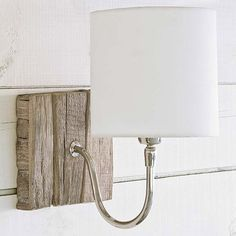 Regina Andrew Reclaimed Wood Bent Arm Pinup Sconce - Might be a simple enough DIY light & could replace the wood back with almost any material.