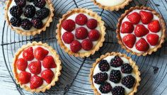 Nice fruit tarts - baked pastry case filled with soft custard and topped with fruit. Good for making with fresh fruit in late summer.