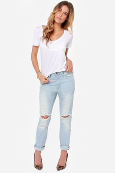 "The RES Denim Slacker Distressed Boyfriend Jeans are every professional lounger's dream! A slouchy, relaxed fit and ripped details down the legs add a rock and roll feel to the light wash denim, perfect for wearing cuffed or relaxed. Pants are topped with belt loops, a five pocket cut, circular logo tag at back, and a hidden zip fly with branded top button closure. Unlined. Model is 5'8"" and is wearing a size 24. 98.5% Cotton, 1.5% Elastane. Machine Wash Cold. Imported."